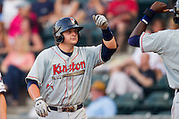 Jeremie Tice #38 of the Kinston Indians is congratulated by teammate Abner Abreu #16 after hitting a solo home run against the Winston-Salem Dash at BB&T Ballpark on June 4, 2011 in Winston-Salem, North Carolina.   Photo by Brian Westerholt / Four Seam Images