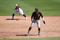Pittsburgh Pirates Erik Gonzalez (2) leads off in front of shortstop Freddy Galvis (2) during a Major League Spring Training game against the Baltimore Orioles on February 28, 2021 at Ed Smith Stadium in Sarasota, Florida.  (Mike Janes/Four Seam Images)