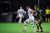 LAKE BUENA VISTA, FL - AUGUST 11: Santiago Patino #29 of Orlando City SC battles for the ball during a game between Orlando City SC and Portland Timbers at ESPN Wide World of Sports on August 11, 2020 in Lake Buena Vista, Florida.