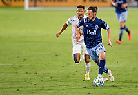 CARSON, CA - OCTOBER 18: Russell Teibert #31 of the Vancouver Whitecaps moves with the ball during a game between Vancouver Whitecaps and Los Angeles Galaxy at Dignity Heath Sports Park on October 18, 2020 in Carson, California.