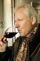 "Switzerland. Canton Ticino. Ligornetto. Luigi Zanini. Wine grower and producer. Owner of the firm ""Vinattieri Ticinesi"" . Luigi Zanini is smelling with his nose and tasting a 2007 Merlot red wine. Wineglass. © 2008 Didier Ruef"