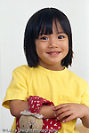 2 year old toddler girl portrait, closeup, holding favorite stuffed toy