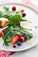 Herb salad with summer berries and parmesan