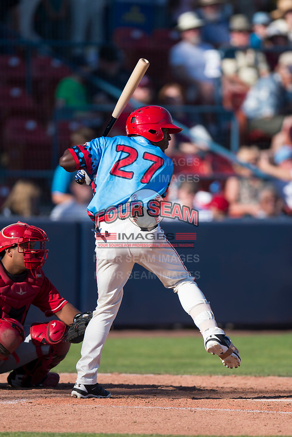 Spokane Indians center fielder Julio Pablo Martinez (27) at bat in front of catcher Yorman Rodriguez (13) during a Northwest League game against the Vancouver Canadians at Avista Stadium on September 2, 2018 in Spokane, Washington. The Spokane Indians defeated the Vancouver Canadians by a score of 3-1. (Zachary Lucy/Four Seam Images)