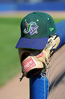 Jamestown Jammers hat and glove on the dugout post before a game against the Williamsport Crosscutters on June 20, 2013 at Russell Diethrick Park in Jamestown, New York.  Jamestown defeated Williamsport 12-6.  (Mike Janes/Four Seam Images)