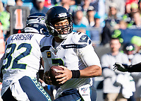 CHARLOTTE, NC - DECEMBER 15: Russell Wilson #3 of the Seattle Seahawks drops back to pass during a game between Seattle Seahawks and Carolina Panthers at Bank of America Stadium on December 15, 2019 in Charlotte, North Carolina.