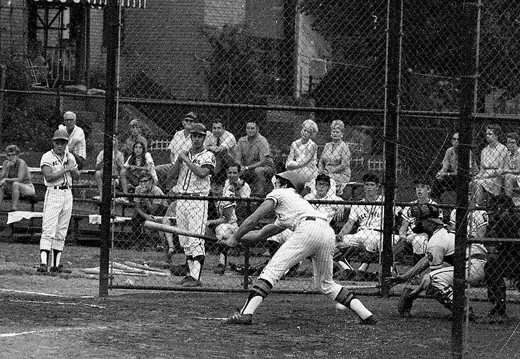 Ford City PA:  Bethel Park vs Arnold to advance to the state American Legion Playoffs. Mike Stewart swinging and missing during the game with Jack Snyder on deck.  Bob Purkey pitched a shut out (1-0) and the team advanced to the state playoffs in Allentown PA.  Gary Biro on deck. Others in the photo; Mr. and Mrs. Bob Purkey Sr, Mike Stewart, Paul Hauck, Skip Uhl, and Craig Balmford.