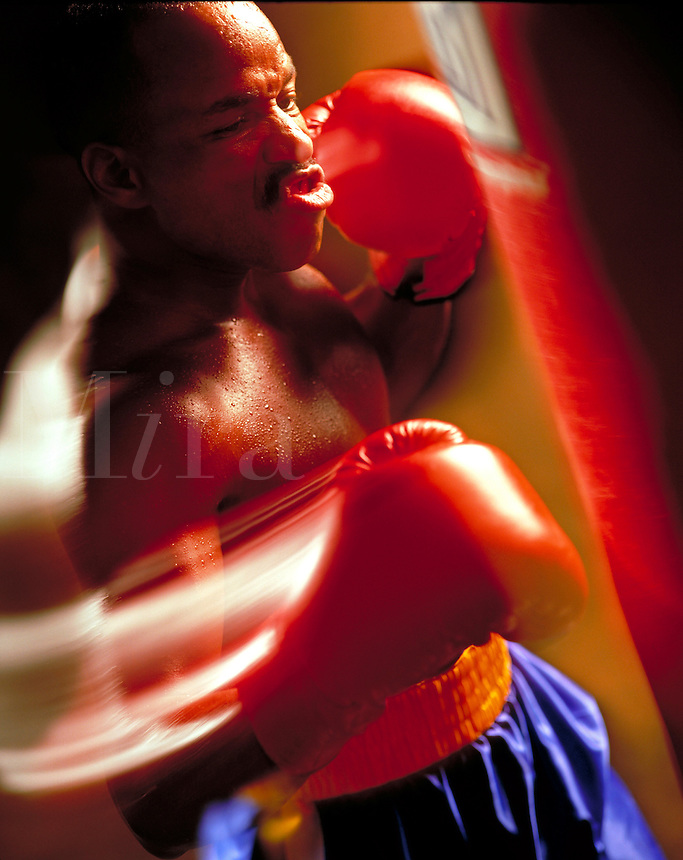 Boxer working out by using a punching bag Billboard and broadcast must be negotiated, due to talent agreement. Boxer. United States.