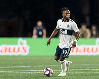 FOXBOROUGH, MA - JULY 18: Lass Bangoura #19 looks to pass during a game between Vancouver Whitecaps and New England Revolution at Gillette Stadium on July 18, 2019 in Foxborough, Massachusetts.