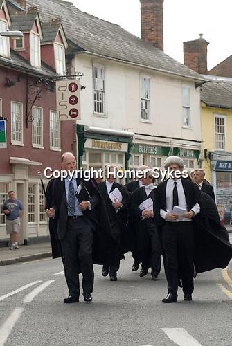 Dunmow Flitch Trial. Great Dunmow, Essex. UK 2008. Court officcials arrive walk down High Street to Saracens Head.