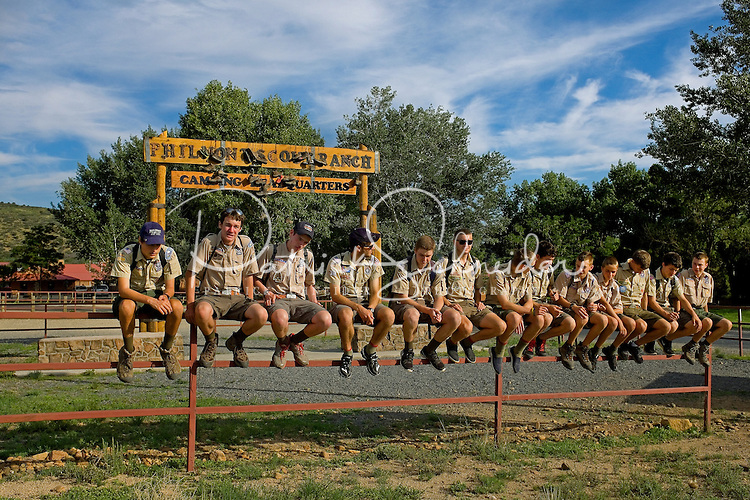 Photo story of Philmont Scout Ranch in Cimarron, New Mexico, taken during a Boy Scout Troop backpack trip in the summer of 2013. Photo is part of a comprehensive picture package which shows in-depth photography of a BSA Ventures crew on a trek. In this photo,  a proud BSA Venture crew hangout as a group before departing the Philmont Scout Ranch  after completing their crew trek in the backcountry. <br /> <br /> Photo by travel photograph: PatrickschneiderPhoto.com