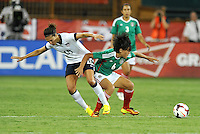 Liliana Mercado (6) of Mexico goes against Carli Lloyd (10) of the USWNT.  The USWNT defeated Mexico 7-0 during an international friendly, at RFK Stadium, Tuesday September 3 , 2013.