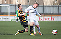 Alloa's Michael Doyle goes into the back of Raith Rovers' Fraser Mullen.