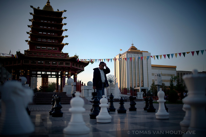 Men play chess open air chess on a massive board in Lenin Square, Elista, Republic of Kalmykia, Russian Federation on May 13, 2010. Kalmykia is known as an international chess mecca, due to the fact that its President, Kirsan Ilyumzhinov, is the head of the International Chess Federation (FIDE). Chess is mandatory in primary schools though out the autonomous republic.