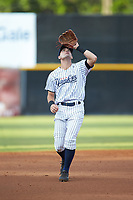 Pulaski Yankees shortstop Max Burt (17) settles under a pop fly during the game against the Princeton Rays at Calfee Park on July 14, 2018 in Pulaski, Virginia. The Rays defeated the Yankees 13-1.  (Brian Westerholt/Four Seam Images)