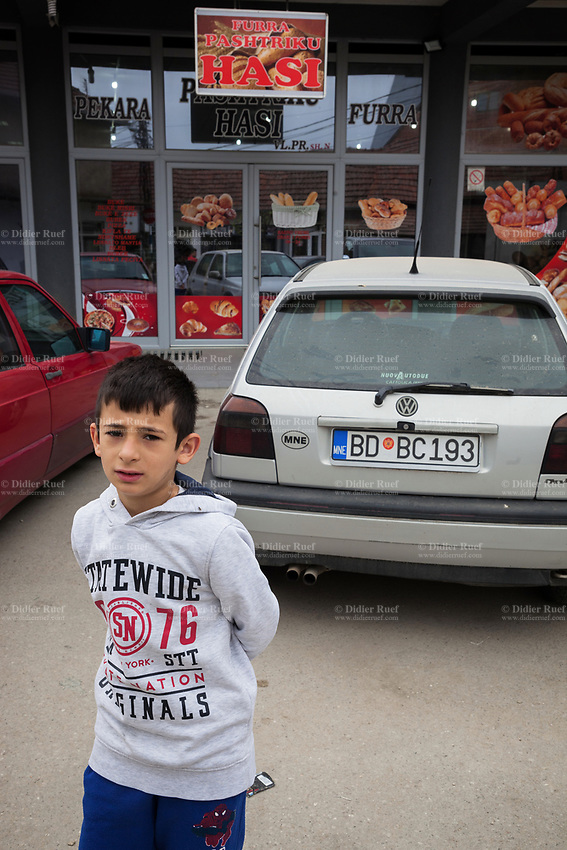 Serbia. Veliki Trnovac (in Albanian: Tërnoc i Madh) is a town in the municipality of Bujanovac, located in the Pčinja District of southern Serbia. An Albanian boy stands on the road in front of a bakery. Cars are parked on the street. Street life. Bujanovac is located in the geographical area known as Preševo Valley. The Pestalozzi Children's Foundation (Stiftung Kinderdorf Pestalozzi) is advocating access to high quality education for underprivileged children. It supports in Bujanovac a project called» Our towns, our schools». 16.4.2018 © 2018 Didier Ruef for the Pestalozzi Children's Foundation