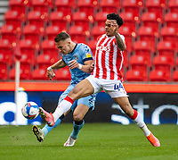 21st April 2021; Bet365 Stadium, Stoke, Staffordshire, England; English Football League Championship Football, Stoke City versus Coventry; Leo Ostigard of Coventry City is tackled by Christian Norton of Stoke City