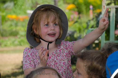 Young girl at garden camp participating in music group, Community Garden, Maine, USA