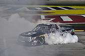 #51: Kyle Busch, Kyle Busch Motorsports, Toyota Tundra Cessna, does a burnout after winning