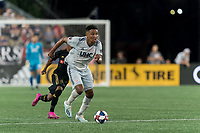 FOXBOROUGH, MA - AUGUST 4: Teal Bunbury #10 of New England Revolution on the attack during a game between Los Angeles FC and New England Revolution at Gillette Stadium on August 3, 2019 in Foxborough, Massachusetts.