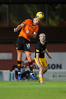 2nd October 2020; Tannadice Park, Dundee, Scotland; Scottish Premiership Football, Dundee United versus Livingston; Ryan Edwards of Dundee United heads clear from Scott Robinson of Livingston
