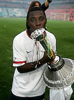 USA's Freddy Adu kisses the Nelson Mandela challenge trophy after the match between the national teams of South Africa (RSA) and the United States (USA) in an international friendly dubbed the Nelson Mandela Challenge at Ellis Park Stadium in Johannesburg, South Africa on November 17, 2007. The United States defeated South Africa 1-0.
