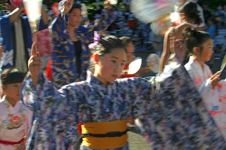Seattle, Kimono clothed young Japanese woman dancer, Bon Odori Festival, Seafair, summer city festival,  Pacific Northwest, Washington State, USA,.