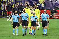 NASHVILLE, TN - SEPTEMBER 23: Referee Tori Penso carries the match ball while she and assistant referees Logan Brown and Jeremy Hanson and fourth official Robert Sibiga lead the starters for Nashville and DC onto the field before a game between D.C. United and Nashville SC at Nissan Stadium on September 23, 2020 in Nashville, Tennessee.