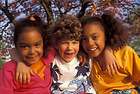 AJ3468, friendship, african-american, multi-ethnic, pals, Two (black, African American) girls and one (white, Caucasian) girl with arms around each other and smiling together on a warm spring day in Exton in the state of Pennsylvania. The white girl is in between the two black girls.