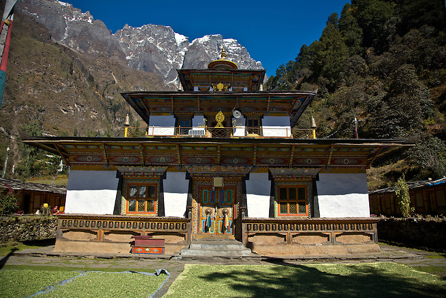 A TIBETAN BUDDHIST TEMPLE with drying herbs in a remote valley - NEPAL HIMALAYA
