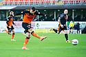 Dundee Utd's Nadir Ciftci scores their first goal.