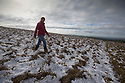 10/04/16 <br /> <br /> A woman walks through a very wintery scene after overnight snowfall on Rushup Edge near Chapel-en-le-Frith in the Derbyshire Peak District.<br /> <br /> All Rights Reserved: F Stop Press Ltd. +44(0)1335 418365   +44 (0)7765 242650 www.fstoppress.com
