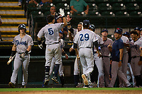 Tampa Tarpons Antonio Gomez (5) celebrates with teammates after hitting a home run during Game One of the Low-A Southeast Championship Series against the Bradenton Marauders on September 21, 2021 at LECOM Park in Bradenton, Florida.  (Mike Janes/Four Seam Images)