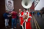 Two musicians in Santa outfits making their way towards the stadium before Burnley hosted Everton in an English Premier League fixture at Turf Moor. Founded in 1882, Burnley played their first match at the ground on 17 February 1883 and it has been their home ever since. The visitors won the match 5-1, watched by a crowd of 21,484.