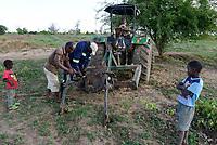 ZAMBIA, Mazabuka, Chikankata area, medium scale farmer Stephen Chinyama with his John Deere Tractor