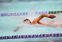 Man swimming in a pool lane