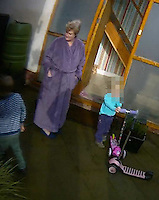 Pictured: Jean Hargreaves (in purple dressing gown) in her house while Trading Standards are searching for evidence<br /> Re: Rogue traders Matthew Hargreaves, John Barry Hargreaves and Jean Hargreaves are due to be sentenced at Merthyr Tydfil Crown Court (Friday 16 September 2016) for selling a teeth whitening product with harmful levels of hydrogen peroxide, 110 times the legal limit, after a three year nationwide investigation by Powys County Council's Trading Standards Service culminated in guilty pleas being entered by three Manchester based rogue traders. <br /> Charges relating to Fraud and Consumer Protection offences were pursued relating to the sale of unsafe teeth whitening products across the UK.