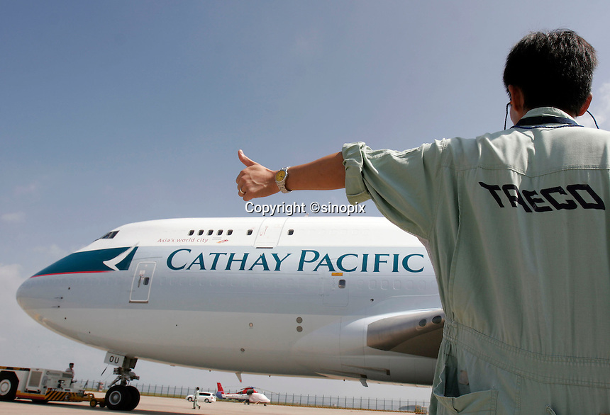 A Cathay Pacific 747 cargo plane taxiing off in front of the Taiko Aircraft Engineering Company's hangar in Xiamen, China..