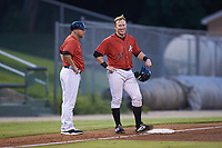 Gunnar Troutwine (37) of the Kannapolis Intimidators smiles as he stands on third base next to manager Ryan Newman (5) during the game against the Hagerstown Suns at Kannapolis Intimidators Stadium on August 27, 2019 in Kannapolis, North Carolina. The Intimidators defeated the Suns 5-4. (Brian Westerholt/Four Seam Images)