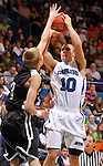 SIOUX FALLS, SD - MARCH 17: St. Thomas More's Eric Hensch spots up for a jumper over Dakota Valley's Blake VanGinkel in the first half of the 2012 Class A Boys Basketball Championship Saturday night at the Sioux Falls Arena.  (Photo by Dave Eggen/Inertia)