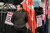 Postal workers picket Royal Mail's Mount Pleasant sorting office, central London, during a national strike by CWU members over wages, conditions and pensions.