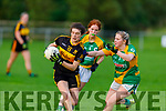 Crokes Kate Stack gets past Jane Carmody of John Mitchels in the Kerry Ladies Junior Football Championship