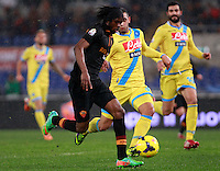 Calcio, semifinale di andata di Coppa Italia: Roma vs Napoli. Roma, stadio Olimpico, 5 febbraio 2014.<br /> AS Roma forward Gervinho, of Ivory Coast, left, runs on his way to score the winning goal as Napoli defender Faouzi Ghoulam, of France, challenges him during the Italian Cup first leg semifinal football match between AS Roma and Napoli at Rome's Olympic stadium, 5 February 2014. AS Roma won 3-2.<br /> UPDATE IMAGES PRESS/Isabella Bonotto
