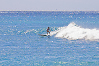 Young woman surfing at Makaha