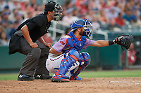 Umpire Luis Hernandez and Frisco RoughRiders catcher Isiah Kiner-Falefa (9) during a Texas League game against the Amarillo Sod Poodles on July 13, 2019 at Dr Pepper Ballpark in Frisco, Texas.  (Mike Augustin/Four Seam Images)