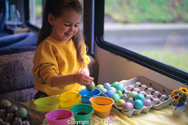 Girl coloring Easter eggs  Jim Corwin Photographer