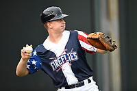 Catcher Dan Rizzie (5) of the Columbia Fireflies warms up before a game against the Rome Braves on Monday, July 3, 2017, at Spirit Communications Park in Columbia, South Carolina. Columbia won, 1-0. (Tom Priddy/Four Seam Images)