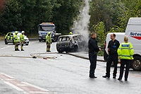 Pictured: A red Renault car lies gutted by a fire at the side of the road. Wednesday 08 August 2018<br /> Re: Fire fighters had to attend the scene of a red Renault car which caught fire on the A467 near Crumlin, Wales, UK.
