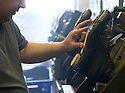 01/05/16<br /> <br /> James Robinson working a vulcanising machine. Vulcanisation is a chemical process for converting natural rubber into a more durable material used for the sole of work boots.<br /> <br /> Fuelled by a growing trend for vintage cycling, England's last remaining heavy duty boot-maker, tucked away in the heart of the Derbyshire Peak District, is pedalling a new style of footwear.<br /> <br /> Full story here: http://www.fstoppress.com/articles/vintage-cycle-shoes/<br /> <br />  .For hipster retro-cycling enthusiasts after the authentic vintage look, it's the only English manufacturer of leather shoes designed to work with old-fashioned bike pedal clips.<br /> <br /> For well over a century the family-run firm William Lennon and Co has been hand-making safety boots for the surrounding quarry and lead mining industries.<br /> <br /> And now it is applying the same high level of traditional skill and quality to old-style cycle shoes.<br /> <br /> Located in the small village of Stoney Middleton, the company produces more than 500 pairs of work boots a week and started to make the toe-clip cycle shoes around seven years ago, when the only other manufacturer in Leeds shut down.<br /> <br /> <br /> All Rights Reserved: F Stop Press Ltd. +44(0)1335 418365   www.fstoppress.com.