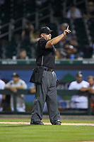 Home plate umpire Jeremy Riggs indicates there is one warm-up pitch left between innings of the International League game between the Toledo Mud Hens and the Charlotte Knights at BB&T BallPark on April 24, 2019 in Charlotte, North Carolina. The Knights defeated the Mud Hens 9-6. (Brian Westerholt/Four Seam Images)